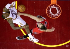 Cleveland Cavaliers forward LeBron James (23) shoots over Chicago Bulls center Joakim Noah during the first half of Game 1 in a second-round NBA basketball playoff series Monday, May 4, 2015, in Cleveland. (AP Photo/Tony Dejak)