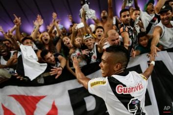 Vasco's Madson celebrates with fans after winning the Rio de Janeiro state championship against Botafogo 2-1 at the Maracana stadium in Rio de Janeiro, Brazil, Sunday, May 3, 2015. (AP Photo/Felipe Dana)