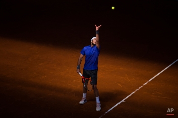 Juan Monaco from Argentina serves during the Madrid Open tennis tournament match against Milos Raonic from Canada in Madrid, Spain, Tuesday, May 5, 2015. (AP Photo/Andres Kudacki)