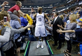 Memphis Grizzlies guard Vince Carter (15) celebrates with fans as he leaves the court after the Grizzlies defeated the Portland Trail Blazers in Game 5 of an NBA basketball playoff series Wednesday, April 29, 2015, in Memphis, Tenn. The Grizzlies won 99-93 to win the series 4-1. (AP Photo/Mark Humphrey)