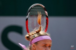 Slovakia's Anna Schmiedlova serves in the first round match of the French Open tennis tournament against Belgium's Alison van Uytvanck at the Roland Garros stadium, in Paris, France, Tuesday, May 26, 2015. (AP Photo/Christophe Ena)