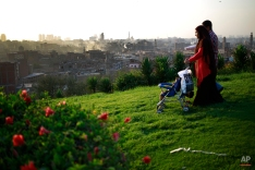 An Egyptian couple spends time at Al-Azhar Park, one of the bustling city's few public parks as the sun sets in Cairo, Egypt, Friday, May 8, 2015. (AP Photo/Hassan Ammar)
