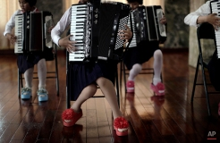 School girls perform a song during an accordion class, Thursday, May 7, 2015, in Pyongyang, North Korea. The Pyongyang School Children's Palace is a place where talented school children go for extracurricular classes, and is one of the places tourists visit during their stay in Pyongyang. (AP Photo/Wong Maye-E)
