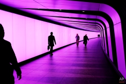 People walk through an underground passage leading out of King's Cross and St. Pancras underground tube station, London, Tuesday, May 5, 2015. (AP Photo/David Azia)