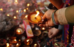 A devotee performs rituals with a lamp at the historic Kheer Bhawani temple in Tul Mul, some 30 kilometers northeast of Srinagar, India, Tuesday, May 26, 2015. Hundreds of Hindu devotees attended the prayers in the historic Kheer Bhavani Temple during an annual festival dedicated to Hindu Goddess Durga. (AP Photo/Mukhtar Khan)