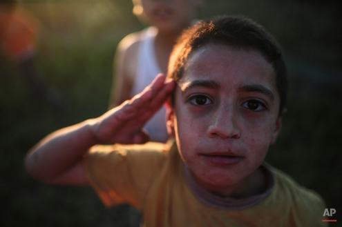 Hasan, 3, poses for a portrait while playing outsider his home in the Nile Delta town of Behira, 300 kilometers (186 miles) north of Cairo, Egypt, Wednesday, May 6, 2015. (AP Photo/Mosa'ab Elshamy)