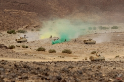"""Jordanian soldiers along with tanks participate in 18-nation military exercises in a field near the border with Saudi Arabia, in Mudawara, 280 kilometers (174 miles) south of Amman, Jordan, Monday, May 18, 2015. Some 10,000 troops took part in the two-week """"Eager Lion"""" exercises hosted by Jordan for the fifth year. (AP Photo/Raad Adayleh)"""
