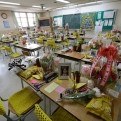 Flowers, notes, and snacks from classmates and family paying tribute to the victims of the sinking of ferry Sewol are placed on the desks in a classroom at Danwon High School in Ansan, South Korea, April 10, 2015. Surrounded by the buzz of regular school life, a few classrooms at Danwon High School stand apart. They have become part shrine, part refuge, part confessional. The Sewol ferry sank on April 16, 2014, killing 304 people including 250 Danwon High School students on a school trip. (AP Photo/Ahn Young-joon)