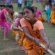 Indian women in traditional dress take part in a tug of war during the Suwori festival in Boko about 75 kilometers (47 miles) west of Gauhati, India, Monday, April 20, 2015. Traditional elephant fights, elephant races, tug of war and dances mark this festival which coincides with the Assamese Rongali Bihu, or the harvest festival of the northeastern Indian state of Assam. (AP Photo/Anupam Nath)