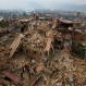Rescue workers remove debris as they search for victims of an earthquake in Bhaktapur near Kathmandu, Nepal, Sunday, April 26, 2015. A strong magnitude earthquake shook Nepal's capital and the densely populated Kathmandu Valley before noon Saturday, causing extensive damage with toppled walls and collapsed buildings, officials said. (AP Photo/Niranjan Shrestha)