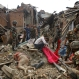 A dead body of a woman is seen after rescue workers recovered it from debris in Bhaktapur near Kathmandu, Nepal, Sunday, April 26, 2015. A strong magnitude-7.9 earthquake shook Nepal's capital and the densely populated Kathmandu Valley before noon Saturday, causing extensive damage with toppled walls and collapsed buildings, officials said. (AP Photo/Niranjan Shrestha)