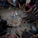 Nepalese villagers charge their cell phones in an open area in Kathmandu, Nepal, Monday, April 27, 2015. Shelter, fuel, food, medicine, power, news, workers — Nepal's earthquake-hit capital was short on everything Monday as its people searched for lost loved ones, sorted through rubble for their belongings and struggled to provide for their families' needs. (AP Photo/Bernat Armangue)