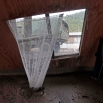 A military truck transporting aid is framed in the window of a home destroyed by a volcanic mudflow, in an area along the Rio Blanco in Puerto Montt, Chile, Saturday, April 25, 2015. Authorities urged 2,000 people living near the volcano to evacuate Friday after potentially devastating mudflows of volcanic debris were detected in a nearby river, the result of two huge eruptions this week that sent ash across large swaths of southern South America. (AP Photo/Luis Hidalgo)