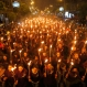 Armenians walk with torches to the monument to the victims of mass killings by Ottoman Turks, in Yerevan, Armenia, Friday, April 24, 2015. Armenians on Friday marked the centenary of what historians estimate to be the slaughter of up to 1.5 million Armenians by Ottoman Turks, an event widely viewed by scholars as genocide. Turkey, however, denies the deaths constituted genocide and says the death toll has been inflated. (AP Photo/Sergei Grits)