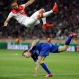 Monaco's Layvin Kurzawa is in the air above /Juventus' Stephan Lichtsteiner during the Champions League quarterfinal second leg soccer match between Monaco and Juventus at Louis II stadium in Monaco, Wednesday, April 22, 2015. (AP Photo/Michel Euler)
