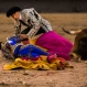 """Bullfighter Antonio Puerta, bottom, gets help from a bullfighter """"banderillero"""" after he was gored by a bull during a bullfight at Las Ventas bullring in Madrid, Spain, Sunday, April 26, 2015. Bullfighting is a traditional spectacle in Spain and the season runs from March to October. (AP Photo/Andres Kudacki)"""