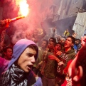 An Egyptian youth carries a lit flare as supporters of the Muslim Brotherhood gather in the El-Mataria neighborhood of Cairo, Egypt, to protest the 20-year sentence for ousted president Mohammed Morsi and verdicts against other prominent figures of the Brotherhood on Friday, April 24, 2015. (AP Photo/Belal Darder)