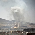 Smoke rises after a Saudi-led airstrike hit a site where many believe the largest weapons cache in Yemen's capital, Sanaa, on Tuesday, April 21, 2015. The Saudi-led coalition pounded Shiite rebels in Yemen on Tuesday, killing at least 19 in a city in the country's west, officials said. (AP Photo/Hani Mohammed)