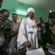 President Omar al-Bashir casts his ballot as he runs for another term, on the first day of the presidential and legislative elections, in Khartoum, Sudan Monday, April 13, 2015. Al-Bashir won re-election with 94 percent of the vote, according to official results announced Monday, April 27, 2015, extending his 25-year rule despite international war crimes charges and multiple insurgencies. (AP Photo/Mosa'ab Elshamy)