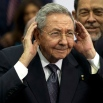 Cuba's President Raul Castro cups his ears to better hear a question shouted out at him during the official group photo of the VII Summit of the Americas, in Panama City, Panama, Saturday, April 11, 2015. In a speech to world leaders at the opening plenary session, Castro absolved President Barack Obama of fault for the U.S. blockade in a stunning reversal of more than 50 years of animosity between the United States and Cuba. (AP Photo/Moises Castillo)