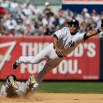 New York Yankees' Gregorio Petit dives to catch a ball thrown by catcher John Ryan Murphy for an error as Boston Red Sox's Xander Bogaerts steals second base during the seventh inning of a baseball game Saturday, April 11, 2015, in New York. Bogaerts advanced to third base on the play. (AP Photo/Frank Franklin II)