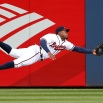 Atlanta Braves center fielder Eric Young Jr. makes a diving attempt for a ball hit for a double by Washington Nationals' Danny Espinosa in the third inning of a baseball game Monday, April 27, 2015, in Atlanta. (AP Photo/John Bazemore)