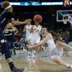 Connecticut forward Breanna Stewart (30) falls to the court as Notre Dame forward Brianna Turner (11) looks on during the first half of the NCAA women's Final Four tournament college basketball championship game, Tuesday, April 7, 2015, in Tampa, Fla. (AP Photo/Brynn Anderson)