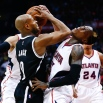 Brooklyn Nets guard Jarrett Jack (0) collides with Atlanta Hawks guard Dennis Schroder (17) during the second half of Game 2 of a first-round NBA playoff basketball playoff series, Wednesday, April 22, 2015, in Atlanta. Atlanta won 96-91. (AP Photo/John Bazemore)