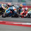 Tito Rabat (1), of Spain, leads Ricard Cardus (88), of Spain, and others out of turn nine during Moto2 qualifying for the MotoGP Grand Prix of the Americas motorcycle race at the Circuit of the Americas, Saturday, April 11, 2015, in Austin, Texas. Rabat qualified third for the race. (AP Photo/Darren Abate)