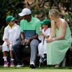 Lindsey Vonn sits with Tiger Woods and his children Sam and Charlie during the Par 3 contest at the Masters golf tournament, Wednesday, April 8, 2015, in Augusta, Ga. (AP Photo/David J. Phillip)