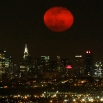 The moon rises in its waning period over the New York City skyline seen from West Orange, N.J., Sunday, April 5, 2015. (AP Photo/Julio Cortez)