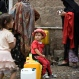 A girl waits for her turn to fill buckets with water from a public tap amid an acute shortage of water, in Sanaa, Yemen, Saturday, May 9, 2015. (AP Photo/Hani Mohammed)