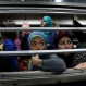 In this Sept. 13, 2014 photo, Egyptian women look from an all-female car at the Shohadaa (Martyrs) metro station in Cairo, Egypt. (AP Photo/Heba Elkholy)