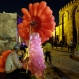 In this Monday, May 18, 2015 photo, An Egyptian cotton candy and balloon vender waits for clients at el-Moez Street in historical Fatimid Cairo, in Egypt. (AP Photo/Amr Nabil)