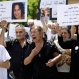Mothers grieve as they hold up placards of their daughters who were killed by their husbands, as they march from the National Museum to the Justice Palace during a campaign held by Kafa (enough) organization to demand an end to domestic violence and the prosecution of men who murder their wives, in Beirut, Lebanon, Saturday, May 30, 2015. (AP Photo/Hassan Ammar)