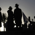 Ultra-Orthodox Jewish men stand near the Damascus Gate in Jerusalem's Old City during a march celebrating Jerusalem Day, Sunday, May 17, 2015. Under heavy police guard, thousands of Israeli demonstrators on Sunday marched through Arab sections of Jerusalem's Old City to celebrate Israel's capture of the area nearly 50 years ago. (AP Photo/Mahmoud Illean)