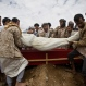 Shiite rebels known as Houthis bury a fellow Houthi who was killed in a Saudi-led airstrike during his funeral in Sanaa, Yemen, Monday, May 25, 2015. (AP Photo/Hani Mohammed)