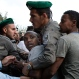 Israeli police detains an Israeli Ethiopian during a demonstration in Tel Aviv, Sunday, May 3, 2015. (AP Photo/Tsafrir Abayov)