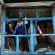 Afghans look out of a damaged shop after a suicide attack in Kabul, Afghanistan, Monday, May 4, 2015. (AP Photo/Rahmat Gul)
