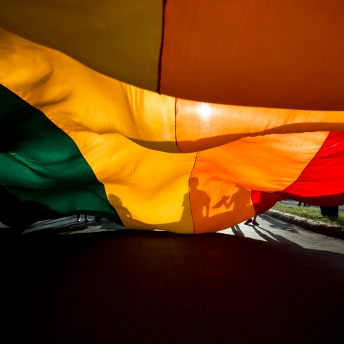 Members of the LGBT movement hold a gay pride flag during a parade celebration in Managua, Nicaragua, Sunday, June 28, 2015. (AP Photo/Esteban Felix)