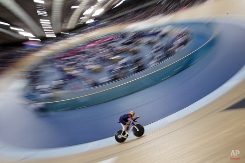 Britain's Sir Bradley Wiggins rides on his way to breaking the UCI Hour Record at the Olympic Velodrome in Lee Valley Velopark, London, Sunday, June 7, 2015. Former Tour de France winner Bradley Wiggins broke cycling's prestigious hour record, covering 54.526 kilometers (33.88 miles) in 60 minutes. (AP Photo/Tim Ireland)