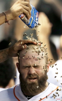 Houston Astros' Evan Gattis gets a sunflower seed shower after hitting a three-run homer against the Baltimore Orioles in the third inning of a baseball game Tuesday, June 2, 2015, in Houston. (AP Photo/Pat Sullivan)