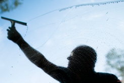 A man cleans the windows at the chancellery in Berlin, Germany, on a sunny and warm spring day, May 7, 2013. (AP Photo/Markus Schreiber)