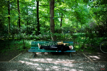Saxophonist and street musician Alex Jam lays on a park bench as he performs for pedestrians at the Tiergarten park near the Brandenburg Gate in central Berlin, Germany, May 6, 2014. (AP Photo/Markus Schreiber)