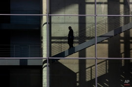 A man walks down the stairs inside a parliament administration building in central Berlin, March 13, 2013. (AP Photo/Markus Schreiber)