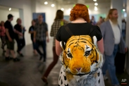 In this Saturday, June 6, 2015 photo, Khirsten Stavola wears a tiger backpack at the CatConLA in Los Angeles. (AP Photo/Jae C. Hong)