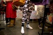 In this Saturday, June 6, 2015 photo, Karen Pennington, center, shops at the first-ever CatConLA, in Los Angeles. (AP Photo/Jae C. Hong)