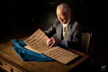 In this April 29, 2015 photo, Yoshiomi Yanai, a survived kamikaze pilot, shows his last will and testament which he made as a kamikaze pilot in 1945 during an exclusive interview with the Associated Press at Tsukuba Naval Air Group Base in Kasama, Ibaraki Prefecture, north of Tokyo. (AP Photo/Eugene Hoshiko)
