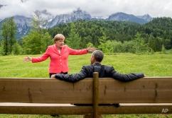German chancellor Angela Merkel speaks with U.S. president Barack Obama at Schloss Elmau hotel near Garmisch-Partenkirchen, southern Germany, Monday June 8, 2015, during the G-7 summit. (Michael Kappeler/Pool Photo via AP)