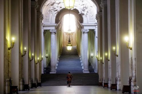 A Vatican Swiss guard holds a briefcase as he walks at the Vatican, June 10, 2015. (AP Photo/Gregorio Borgia)